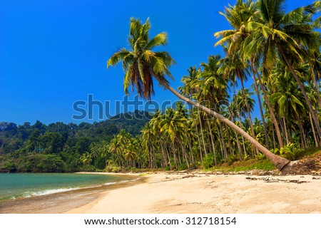 beautiful tranquil lonely beach of a beautiful lagoon. Tropical paradise ideal for relaxation and romantic vacation - stock photo