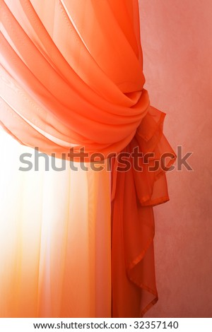 Beautiful translucent red curtains in an apartment - stock photo