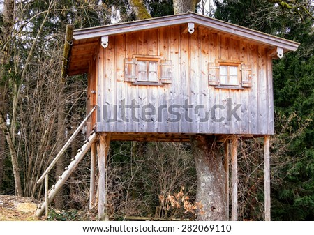 beautiful tree house at a forest - stock photo