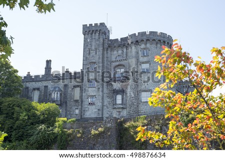 beautiful trees and riverside view of kilkenny castle in ireland