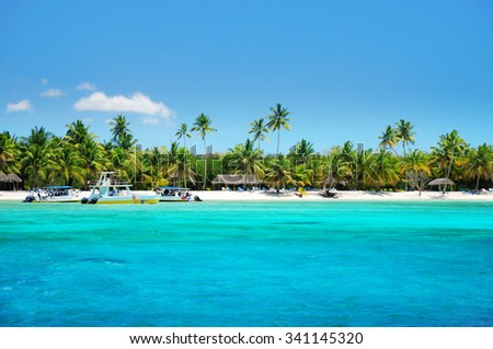 Beautiful tropical beach and boats landscape - stock photo