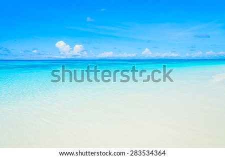 Beautiful tropical beach and sea with blue sky background