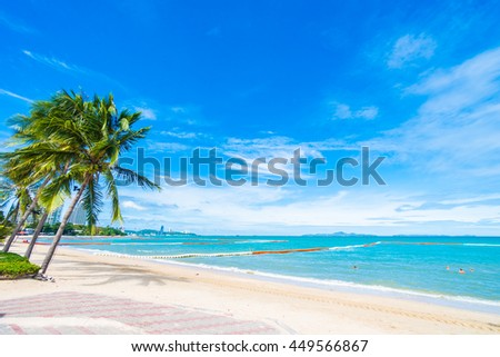 Beautiful tropical beach and sea with coconut palm tree on blue sky background