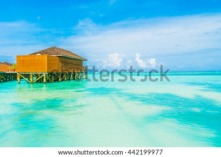 Beautiful tropical beach and sea with water bungalow on blue sky in Maldives island - Boost up color Processing