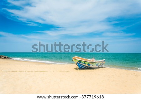 Beautiful Tropical Beach In Kalpitiya, Sri Lanka. These boats used to take people to watch dolphins - stock photo