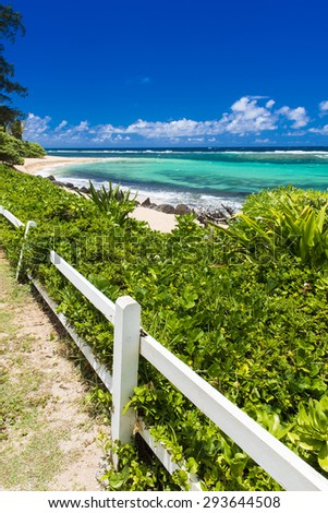 Beautiful tropical beach in Kauai, Hawaii - stock photo