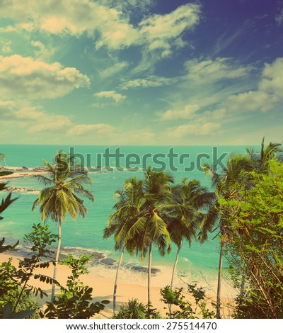 beautiful tropical beach landscape with turquoise sea and clouds - vintage retro style - stock photo