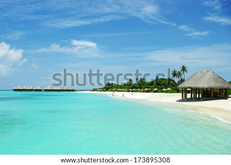 Beautiful tropical beach of island on Maldives - stock photo