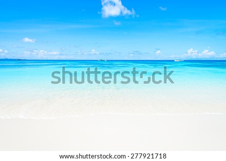 Beautiful tropical beach sand and sea with blue sky background