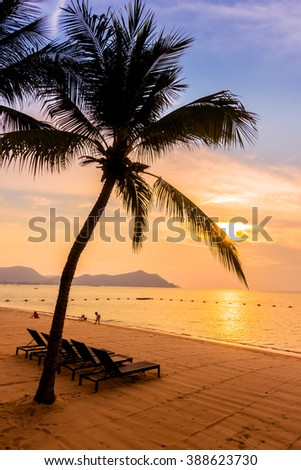 Beautiful tropical beach sea and sand with palm tree for background - Vintage Filter