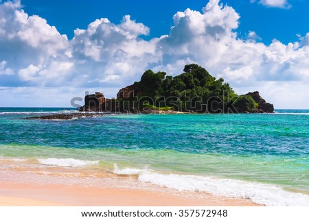 Beautiful tropical beach white sand, turquoise ocean water and blue sky. - stock photo