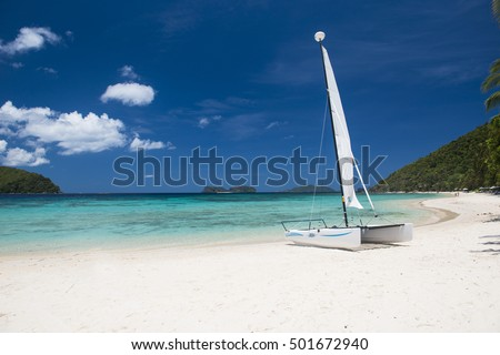 Beautiful tropical beach with a boat.
