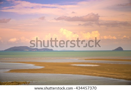 beautiful tropical beach with ebb tide at dawn  - stock photo