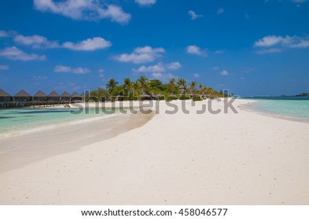 beautiful tropical beach with palm trees, white sand, luxurious water villas. island of maldives Kuredu