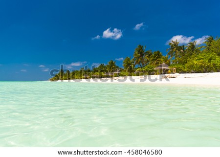 Beautiful tropical beach with palm trees white sand, turquoise water . paradise