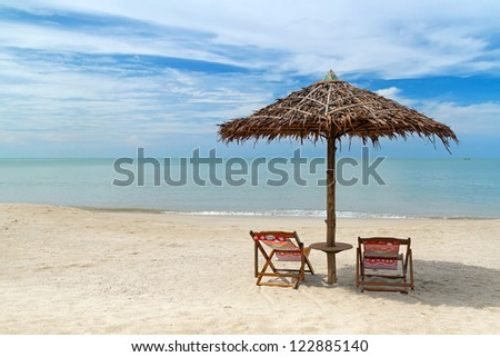 Beautiful tropical beach with parasol in Thailand