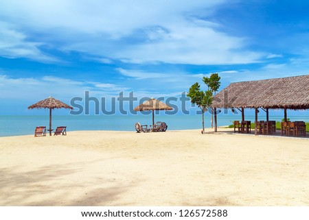 Beautiful tropical beach with parasols, Thailand - stock photo