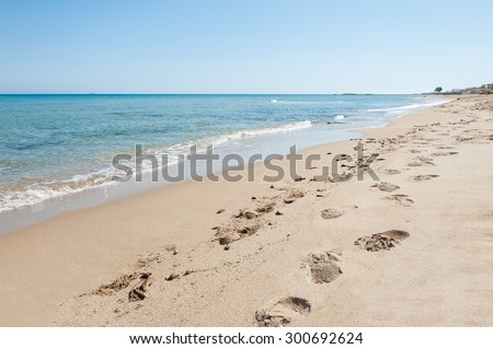 Beautiful tropical beach with turquoise water and white sand. Footprints on the sandy beach