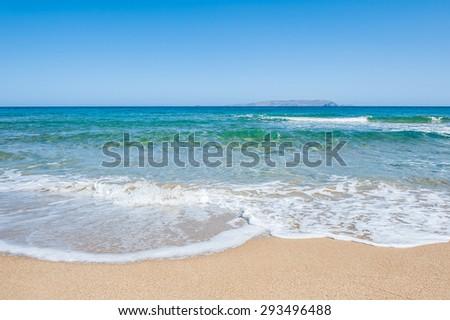 Beautiful tropical beach with turquoise water and white sand. Malia beach, Crete island, Greece. - stock photo