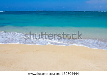 Beautiful tropical blue green water and a white sand beach on the north shore of Oahu in Hawaii. This image shows tropical paradise with a vacation getaway theme in a simple image. - stock photo