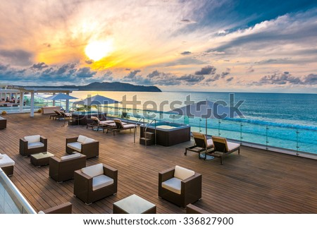 Beautiful tropical, caribbean wooden, flooring ocean beach, resort at sunset, evening, sunrise time.