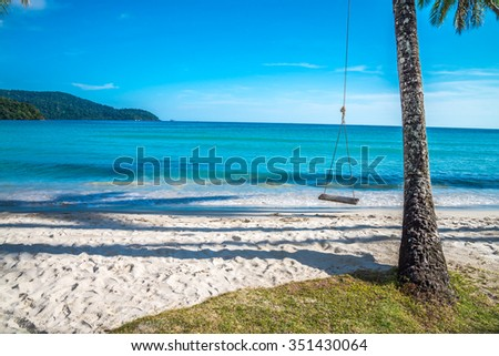 Beautiful tropical island beach with coconut palm trees and swing - Koh Kood, Trat Thailand - stock photo
