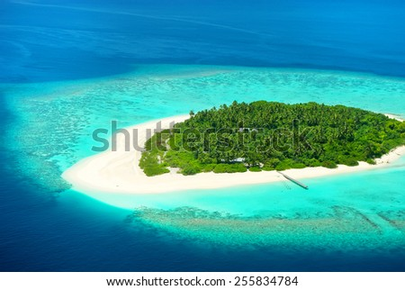 Beautiful tropical island from above. Maldives, Carribean or South see resort. - stock photo