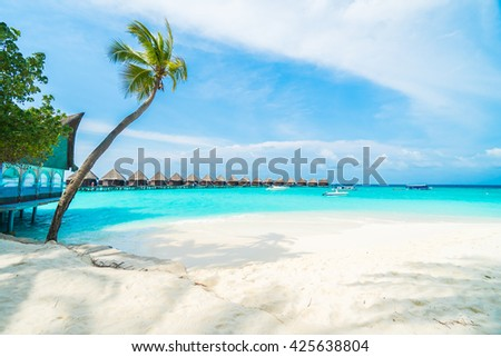 Beautiful tropical Maldives resort hotel and island with beach and sea  and coconut palm tree on sky for holiday vacation background concept - Boost up color Processing - stock photo