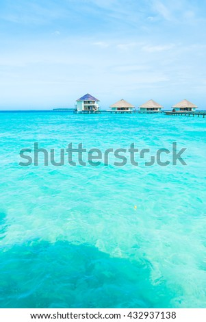 Beautiful tropical Maldives resort hotel and island with beach and sea on sky for holiday vacation background concept - Boost up color Processing