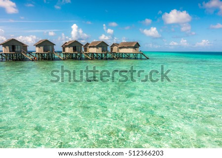 Beautiful tropical Maldives resort hotel with beach and blue water