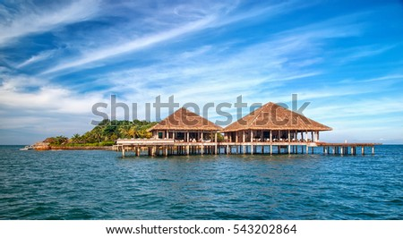 Beautiful tropical resort hotel and island with beach and sea on sky for holiday vacation background concept