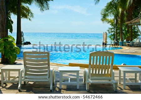 Beautiful tropical resort with palmtrees. - stock photo
