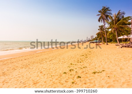 Beautiful tropical sea and beach with palm tree - Vintage Filter