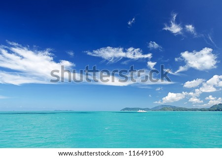 Beautiful tropical sea under the blue sky. - stock photo