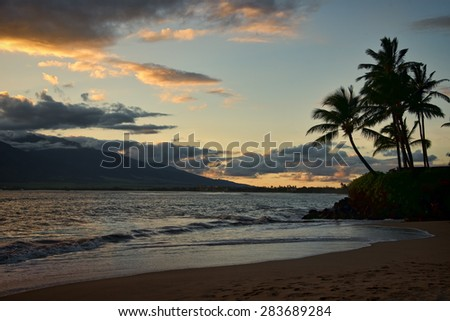 Beautiful tropical sunset on the island of Maui - stock photo