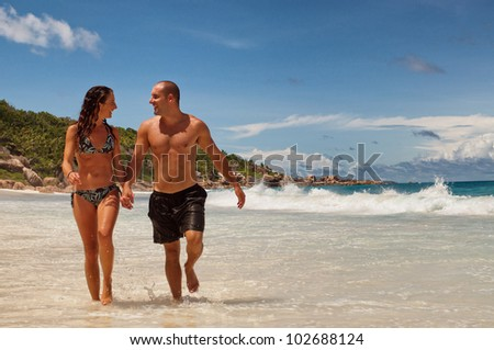 Beautiful tropical vacation in the warm sunny Seychelles island oceans and palm trees - stock photo