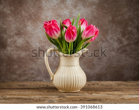 Beautiful tulips bouquet on wooden table. Spring flowers