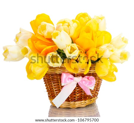 beautiful tulips in basket isolated on white - stock photo