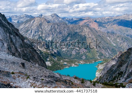 Beautiful turquoise-colored Colchuck Lake as seen from Asgaard Pass in the Upper Enchantment Lakes area of the Alpine Lakes, Washington State, WA, USA - stock photo