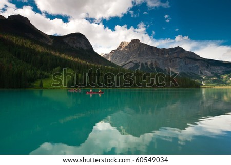 beautiful turquoise emerald lake with canoes in yoho national park canada