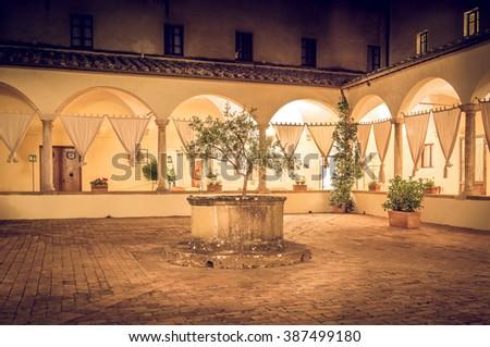 Beautiful tuscan backyard by night in Pienza, Italy - stock photo