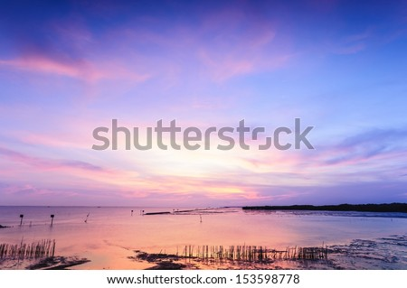 Beautiful twilight silhouette sunset at tropical sea in Thailand. - stock photo