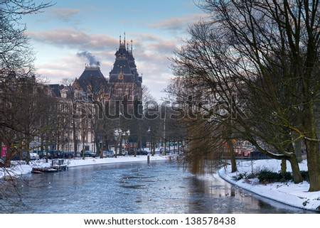 Beautiful twilight view in winter on the Stadhouderskade with the national state museum in the background in Amsterdam, the Netherlands - stock photo