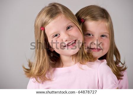 Beautiful twin sisters - stock photo