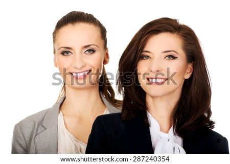 Beautiful two businesswomen wearing office outfits.