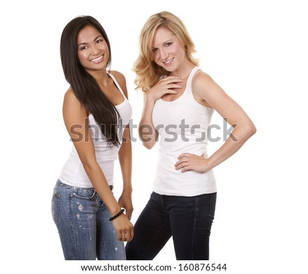beautiful two women wearing casual outfit on white isolated background - stock photo