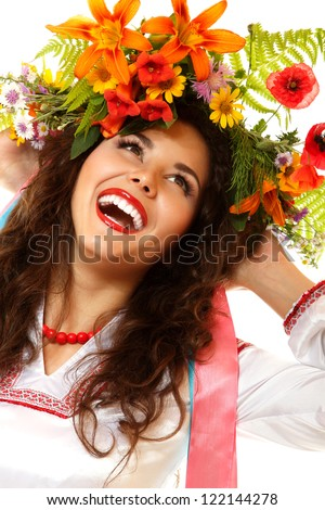 Beautiful ukrainian young woman in garland of summer flowers and native costume dancing on Slavic holiday Ivan-Kupala, on white background - stock photo