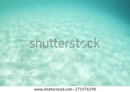 Beautiful underwater white sand bottom - stock photo