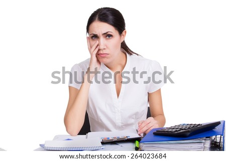 Beautiful upset business woman sitting with documents and thinking about her boss task isolated