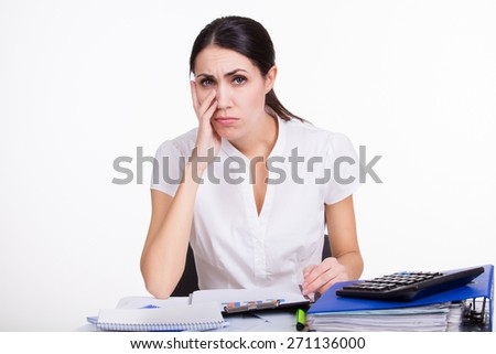 Beautiful upset business woman sitting with documents and thinking about her boss task on white background